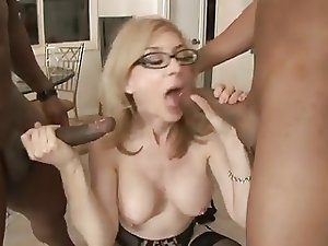 MILF Nina Hartley Takes Two Black Cocks
