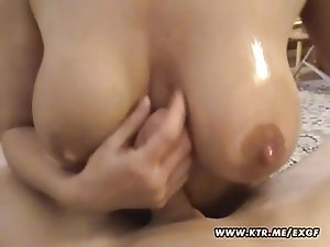 Very busty amateur girlfriend gives a hot titjob